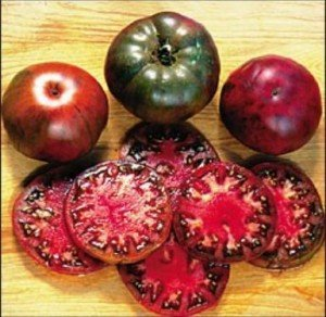 Black Krim - An Heirloom from Russia, Black Krim is a large dark red-purple fruit, with a rich sweet flavour. One of the best, placing high in tomato taste trials. It's very juicy. Also a favourite of many fine chefs.
