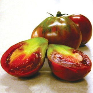 Japanese Black Trifele - A truly transcendent tomato. This pear-shaped fruit has green-streaked shoulders, deepening to a burnished mahogany and finally to a darkened, nearly black base. The meaty interior has similar, opulent shades and an incomparable, almost indescribably complex and rich flavour to match.